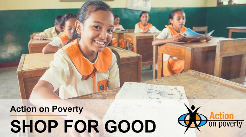 Girl smiling at her desk in a classroom in Timor Leste