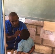 Dr. Francois examining student