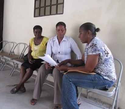 BAI Grassroots Coordinator, Rose Getchine Lima, meets with members of the BAI's Women's Network