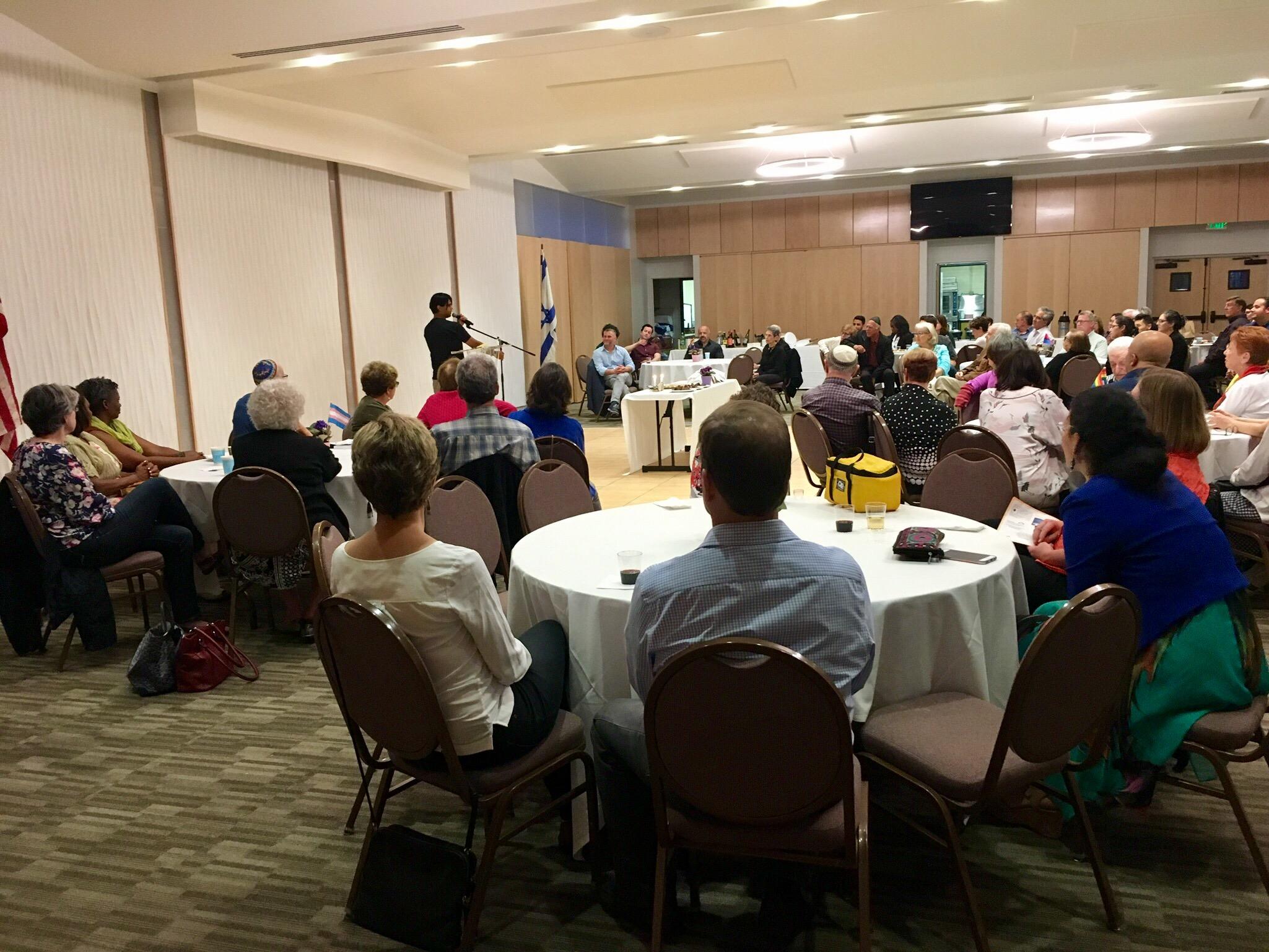 The crowd at JQ's Iftar Shabbat listen in to speaker Jim Ghaznavi.