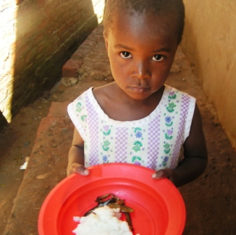 Young Abayudaya girl at lunchtime. Photo by Hadassah Nakiza.