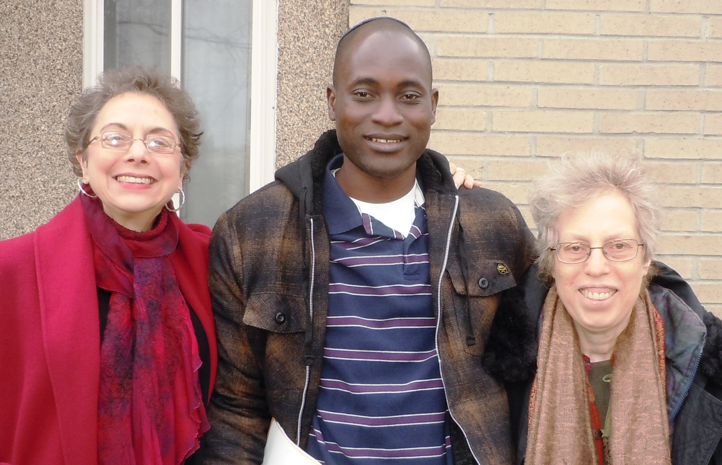 Kulanu board members Judy Manelis (L) and Harriet Bograd (R), with Serge Etele of Cameroon (M) in New York. Photo by Rabbi Sussman, February 2012.