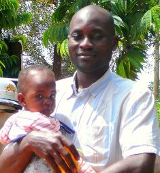 Serge Etele of Saa, Cameroon, with his daughter