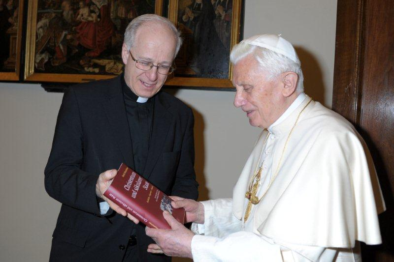 Fr. Rhonheimer presenting his book to Pope Benedict XVI