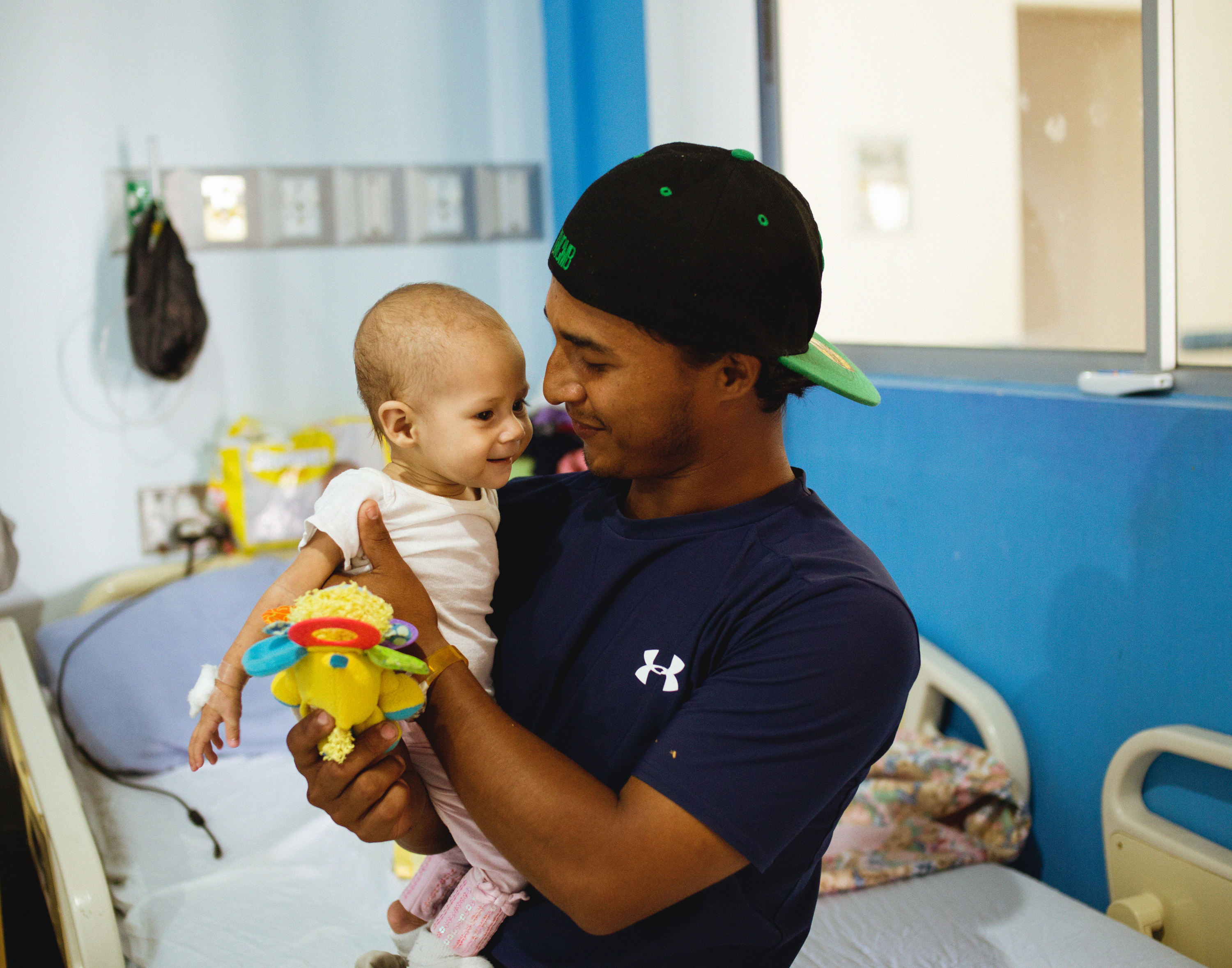 A father holding his daughter who received open-heart surgery with Surgeons of Hope